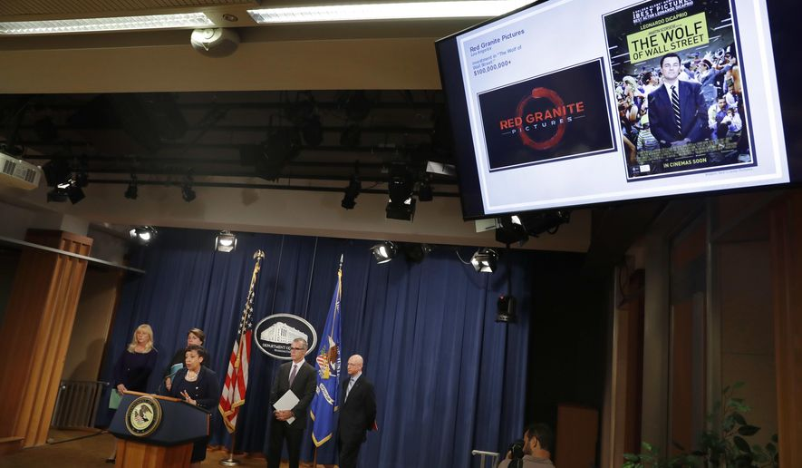 Attorney General Loretta Lynch, center, with from left, U.S. Attorney for the Central District of California Eileen Decker, Assistant Attorney General Leslie Caldwell, FBI Deputy Director Andrew McCabe, and IRS Criminal Division Chief Richard Weber, speaks at a news conference, Wednesday, July 20, 2016, at the Justice Department in Washington, announcing that the U.S. government is seeking the forfeiture of more than $1 billion in assets that federal officials say were misappropriated from a Malaysian sovereign wealth fund. The Justice Department says the funds that were laundered into the U.S. were used for various assets, including real estate and hotel properties, a jet aircraft, fancy artwork and the production of the Oscar-nominated movie, The Wolf of Wall Street. (AP Photo/Jacquelyn Martin)