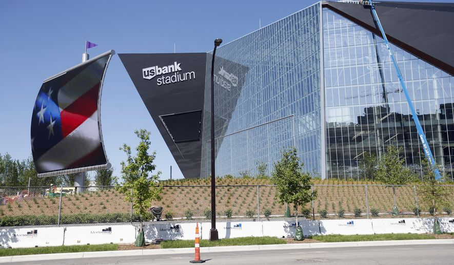 FILE - In this June 2, 2016 file photo, finishing touches are made on U.S. Bank Stadium, the new home of the Minnesota Vikings NFL football team in Minneapolis. ESPN's X Games will be held in Minneapolis in 2017 and 2018, with many of the events being held in the new stadium, the network announced Wednesday, July 20, 2016. (AP Photo/Jim Mone, File)