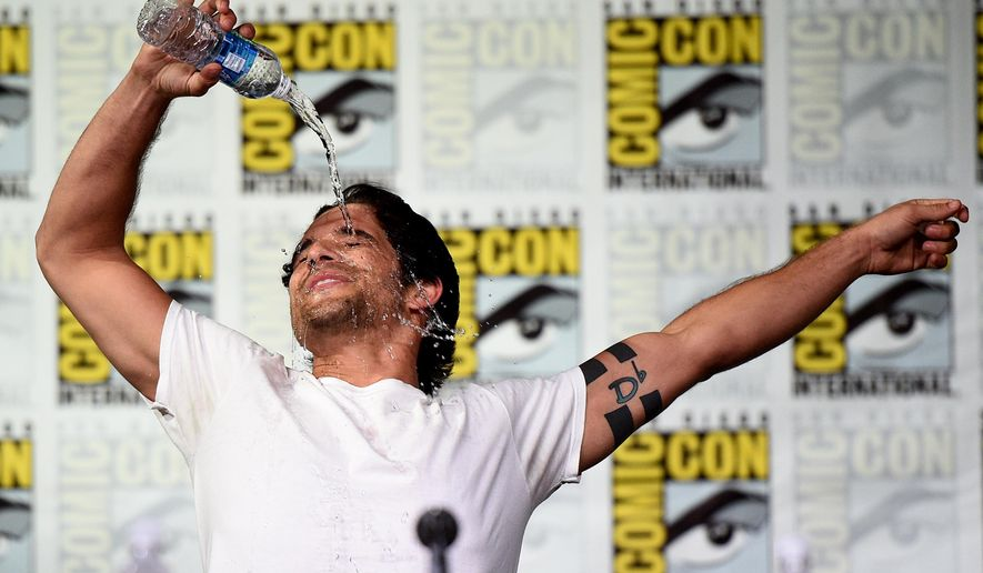 "Tyler Posey reenacts a scene from ""Flashdance"" during the ""Teen Wolf"" panel on day 1 of Comic-Con International on Thursday, July 21, 2016, in San Diego. (Photo by Al Powers/Invision/AP)"