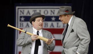 "Abbott and Costello impressionists Lou Sciare, left, and Gil Palmer perform ""Who's on First"" before an awards ceremony on Saturday, July 27, 2013, in Cooperstown, N.Y. (AP Photo/Mike Groll) **FILE**"