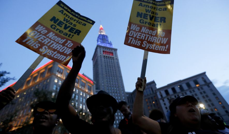 Protesters yell in Public Square on Thursday, July 21, 2016, in Cleveland, during the final day of the Republican convention.(AP Photo/John Minchillo)
