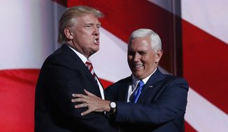 Republican Presidential Candidate Donald Trump greets Republican Vice Presidential Nominee Gov. Mike Pence of Indiana during the third day session of the Republican National Convention in Cleveland, Wednesday, July 20, 2016. (AP Photo/Carolyn Kaster)