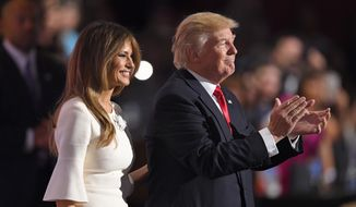 Republican Presidential Candidate Donald Trump and wife Melania Trump smile on stage after Trump's acceptance speech during the final day of the Republican National Convention in Cleveland, Thursday, July 21, 2016. (AP Photo/Mark J. Terrill)