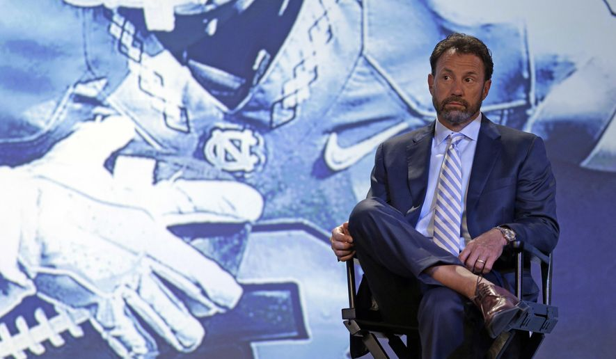 North Carolina head coach Larry Fedora listens to one of his players answer a question during a news conference at the Atlantic Coast Conference Football Kickoff in Charlotte, N.C., Thursday, July 21, 2016. (AP Photo/Chuck Burton)