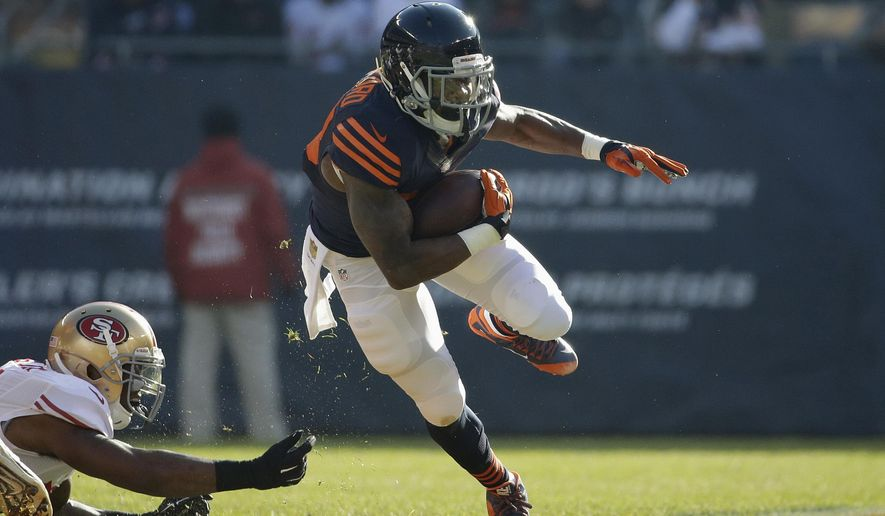 FILE - In this Dec. 6, 2015, file photo, Chicago Bears running back Jeremy Langford (33) rushes during the first half of an NFL football game against the San Francisco 49ers, in Chicago. The decision not to offer two-time Pro Bowler Forte a contract after eight seasons dealt a blow to both the running and passing games. It also created a big opportunity for Jeremy Langford, who showed promise as a rookie and finished with 537 yards rushing and 279 receiving.(AP Photo/Nam Y. Huh, File)