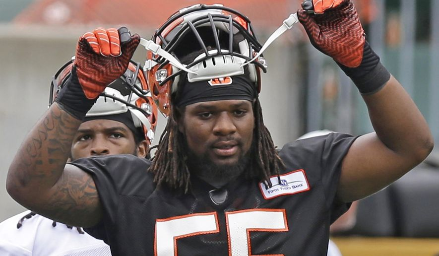 FILE - In this June 10, 2014, file photo, Cincinnati Bengals outside linebacker Vontaze Burfict adjusts his helmet during an NFL football mandatory minicamp in Cincinnati. Middle linebacker Burfict will miss the first three games on an NFL suspension for repeated illegal hits, including his hit to the head of Steelers receiver Antonio Brown during the last-minute meltdown in the playoffs. (AP Photo/File)