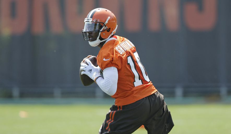 FILe - In this June 1, 2016, file photo, Cleveland Browns quarterback Robert Griffin III looks to pass during practice at the NFL football team's training campin Berea, Ohio. Griffin said he's not overtly trying to win over teammates. He believes his actions will determine how he's perceived.  (AP Photo/Tony Dejak, File)