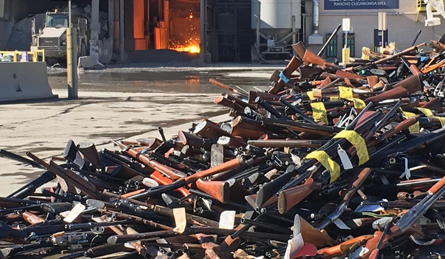 This photo provided by Gerdau Steel Mill shows some of more than 7,000 weapons seized or collected by the Los Angeles County Sheriff's Department, waiting to be melted down in a furnace, rear, in the agency's annual gun melt at Gerdau Steel Mill in Rancho Cucamonga, Calif., Thursday, July 21, 2016. The handguns, rifles and semi-automatic weapons were dumped into furnace at the mill, where they were melted down and will become reinforcing bars for use in construction. (Carlos Puma/Gerdau Steel MIll via AP)