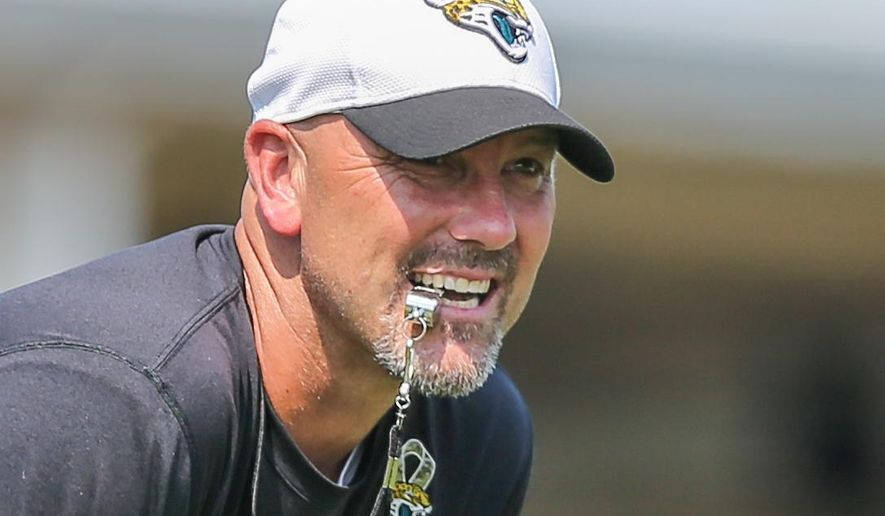 FILE - In this June 14, 2016, file photo, Jacksonville Jaguars head coach Gus Bradley watches during an NFL football minicamp practice in Jacksonville, Fla. The overhaul is complete. The pieces are in place. And for the first time in years, there are expectations for the Jaguars. (AP Photo/Gary McCullough, File)