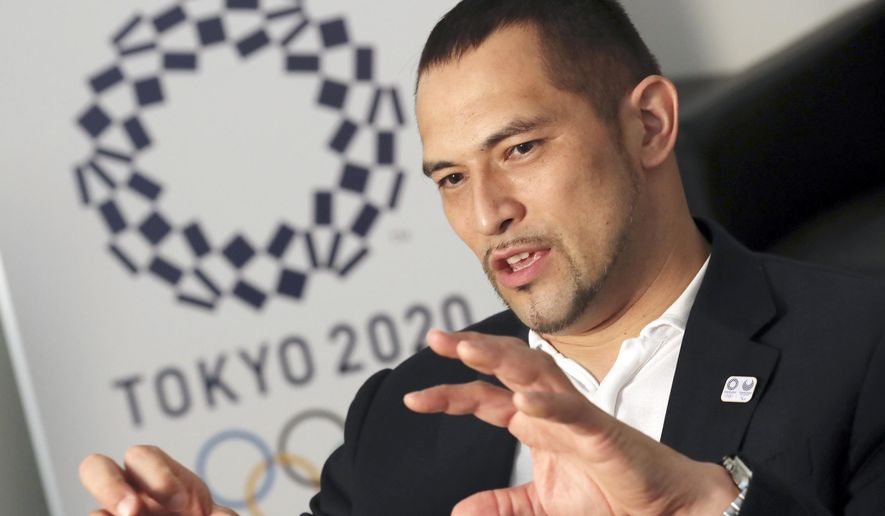 In this July 19, 2016 photo, Koji Murofushi, former Japanese hammer thrower and Olympic gold medalist speaks during an interview with The Associated Press in Tokyo.  Japan is sending 331 athletes to Rio de Janeiro, Brazil,  the country's third-largest delegation at the Olympics after Tokyo in 1964 and Beijing in 2008, and has targeted 14 gold medals - double its tally from London four years ago. Murofushi, the 2004 Olympics hammer throw gold medalist who is now sports director for the 2020 Tokyo organizing committee, says Japan's performance in Rio will be vital in paving the way for success on home soil in the subsequent Summer Games.  (AP Photo/Eugene Hoshiko)
