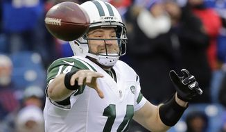 FILE - In this Jan. 3, 2016, file photo, New York Jets quarterback Ryan Fitzpatrick (14) throws a pass during the first half of an NFL football game against the Buffalo Bills in Orchard Park, N.Y. The New York Jets are heading to training camp with their expected starting quarterback still unsigned. Locked for months in a contract stalemate that remains uncertain to be resolved, Fitzpatrick is still waiting for a new deal. (AP Photo/Bill Wippert, File)