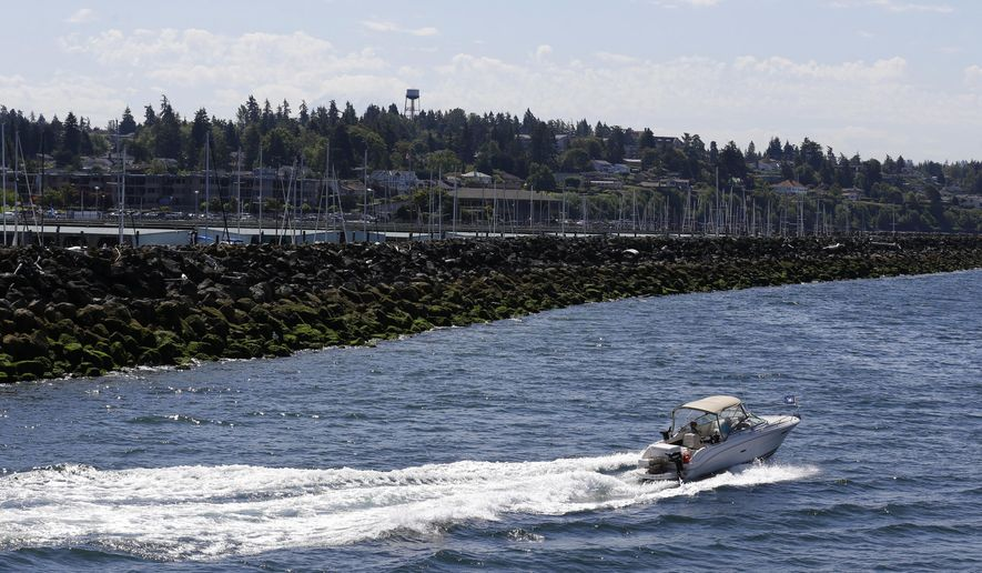"A boat leaves the Des Moines Marina, Thursday, July 21, 2016, in Des Moines, Wash. Washington state officials said Thursday that they have petitioned the U.S. Environmental Protection Agency to designate the waters of Puget Sound a ""no discharge zone,"" which would mean boaters and vessel operators would not be able to release sewage, treated or untreated, into Puget Sound. (AP Photo/Ted S. Warren)"