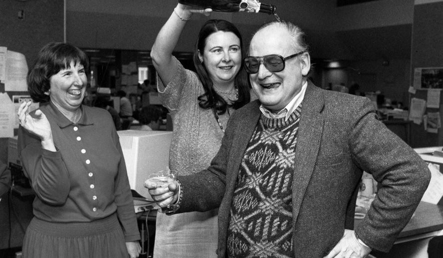 In this March 31, 1988 photo, Barbara Sutton, left, an assistant metro editor, laughs as Ellen Soeteber, assistant managing editor for metropolitan news, pours champagne over the head of reporter William Gaines at the Tribune Tower in Chicago, after The Chicago Tribune won the 1988 Pulitzer Prize. Gaines, who won two Pulitzer Prizes as an investigative reporter for the Chicago Tribune, died Wednesday morning, July 20, 2016,d in hospice care in Munster, Ind., his daughter, Michelle, said Thursday. He was 82.  (Walter Kale/Chicago Tribune via AP)