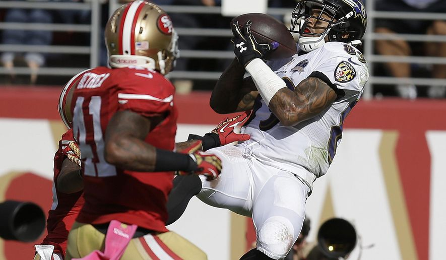 FILE - In this Oct. 18, 2015, file photo, Baltimore Ravens wide receiver Steve Smith (89) catches a 34-yard touchdown pass in front of San Francisco 49ers strong safety Antoine Bethea (41) and cornerback Kenneth Acker during the second half of an NFL football game in Santa Clara, Calif. Smith intended to retire following the 2015 season, but his devastating injury in Week 8 caused him to do an about-face.  He needs 39 receptions to reach 1,000 for his career, and that was a factor in his decision to return.  (AP Photo/Ben Margot), File