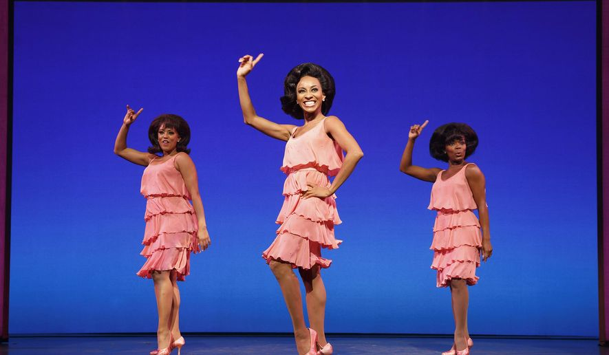 "In this image released by Boneau/Bryan-Brown, from left, Krisha Marcano, Allison Semmes and Trisha Jeffrey appear during a performance of ""Motown The Musical,"" in New York. (Joan Marcus/Boneau/Bryan-Brown via AP)"