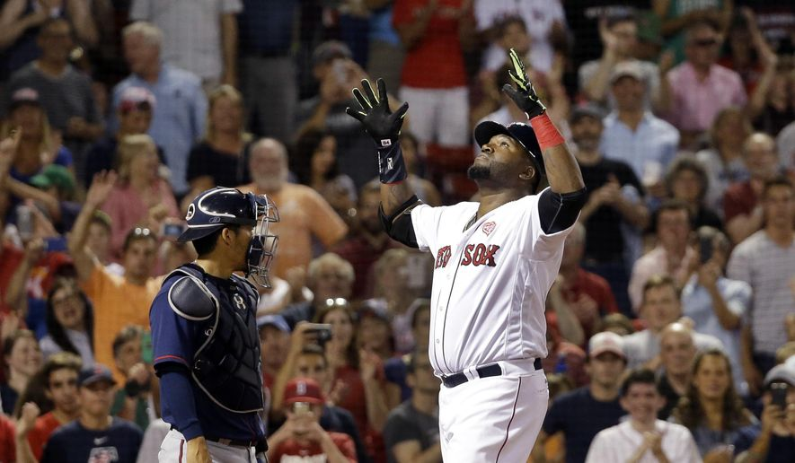 Boston Red Sox designated hitter David Ortiz gestures at the plate in front of Minnesota Twins catcher Kurt Suzuki after hitting a two-run homer in the eighth inning of a baseball game at Fenway Park, Thursday, July 21, 2016, in Boston. (AP Photo/Elise Amendola)