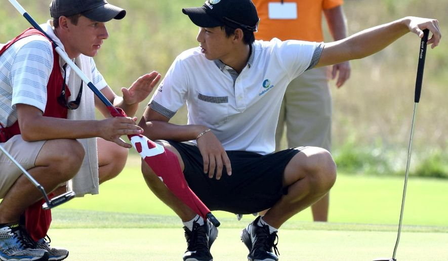 Australia's Min Woo Lee discusses a putt on the eighth green with his caddie during the fourth day of the 69th U.S. Junior Amateur Golf Championship, Thursday, July 21, 2016  in Ooltewah, Tenn. (Robin A. Rudd/Chattanooga Times Free Press via AP) THE DAILY CITIZEN OUT; NOOGA.COM OUT; CLEVELAND DAILY BANNER OUT; LOCAL INTERNET OUT; MANDATORY CREDIT