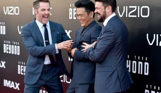 """Chris Pine, from left, John Cho and Karl Urban arrive at the world premiere of """"Star Trek Beyond"""" at the Embarcadero Marina Park South on Wednesday, July 20, 2016, in San Diego. (Photo by Jordan Strauss/Invision/AP)"""