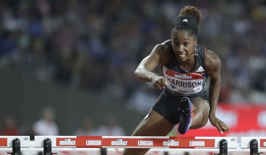 Kendra Harrison of the U.S. clears the final hurdle as she runs on to win the women's 100 meter hurdles in a world record time of 12.20 seconds during the Diamond League anniversary games at The Stadium, in the Queen Elizabeth Olympic Park in London, Friday, July 22, 2016. (AP Photo/Matt Dunham)