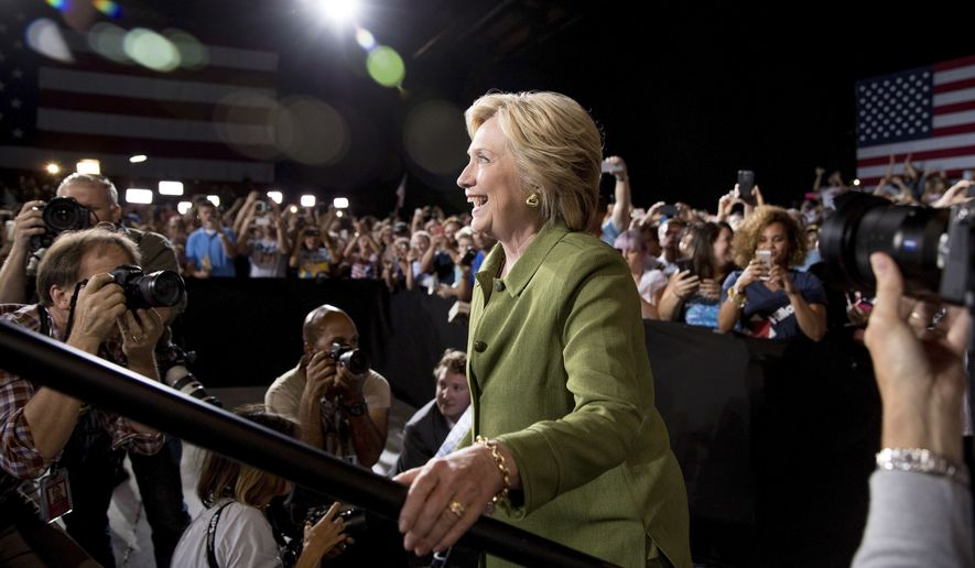 Democratic presidential candidate Hillary Clinton arrives to speak at a rally in Entertainment Hall at the Florida State Fairgrounds in Tampa, Friday, July 22, 2016. (AP Photo/Andrew Harnik)