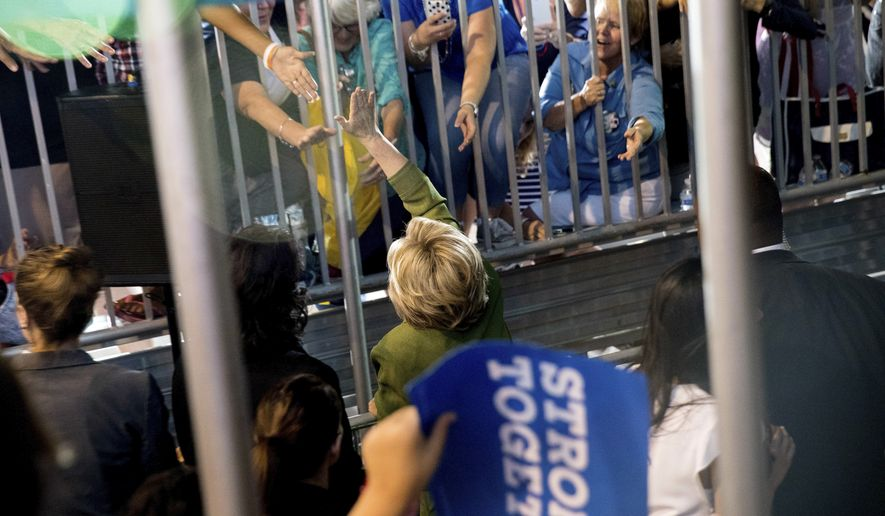 Democratic presidential candidate Hillary Clinton greets members of the audience after speaking at a rally in Entertainment Hall at the Florida State Fairgrounds in Tampa, Friday, July 22, 2016. (AP Photo/Andrew Harnik)
