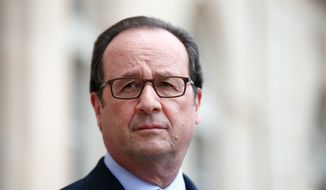 France's President Francois Hollande visits an exhibition during a ceremony marking the first anniversary of the energy transition law, at the Elysee Palce, in Paris, Friday, July 22, 2016. (AP Photo/Thibault Camus, Pool)