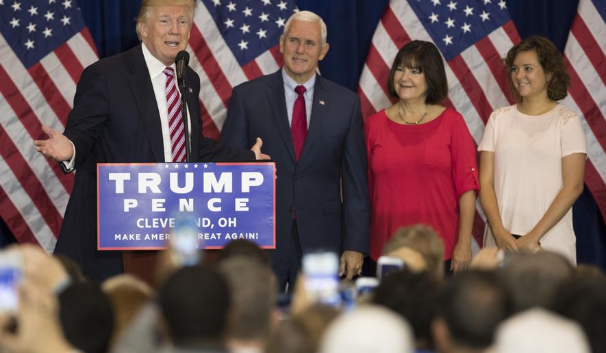 Republican presidential candidate Donald Trump, speaks at a reception with friends and family following the Republican National Convention, Friday, July 22, 2016, in Cleveland. Listening are vice presidential running mate Gov. Mike Pence, R-Ind., Karen Pence, and Charlotte Pence. (AP Photo/Evan Vucci)