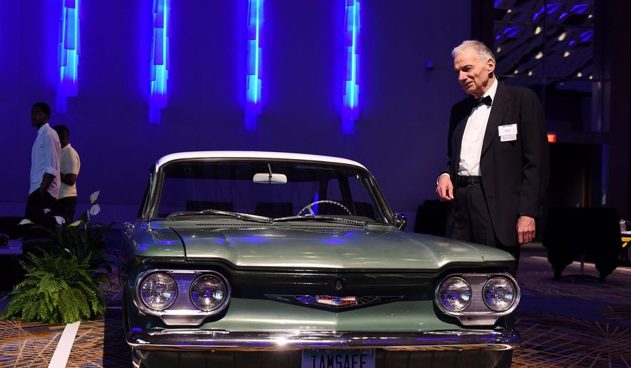 In this Thursday, July 21, 2016 photo, automotive safety advocate Ralph Nader, poses by a 1960 Chevrolet Corvair  at the VIP event before the Automotive Hall of Fame induction ceremony at Cobo Center in Detroit. (Robin Buckson/Detroit News via AP)
