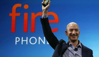 In this June 18, 2014, file photo, Amazon CEO Jeff Bezos introduces the new Amazon Fire Phone in Seattle. Bloomberg's billionaire index shows Bezos moved past Warren Buffet to become the third richest person in the world on Thursday, July 21, 2016. (AP Photo/Ted S. Warren, File)
