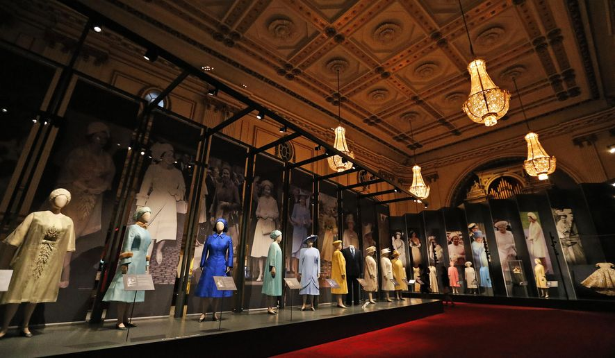 Dresses of Britain's Queen  Elizabeth are on display at an exhibition at Buckingham Palace in London, Thursday, July 21, 2016. In celebration of Her Majesty's 90th birthday this year, visitors to the Summer Opening of the State Rooms at Buckingham Palace will enjoy an unprecedented display of The Queen's outfits, from childhood to the present day, in the special exhibition Fashioning a Reign: 90 Years of Style from The Queen's Wardrobe. (AP Photo/Frank Augstein)