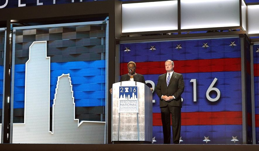 Leah Daughtry, left, CEO of the Democratic National Convention Committee, stands on stage with Philadelphia Mayor Jim Kenney, right, Friday, July 22, 2016, at the Wells Fargo Center in Philadelphia. The convention is scheduled to convene on Monday. (AP Photo/Dake Kang)
