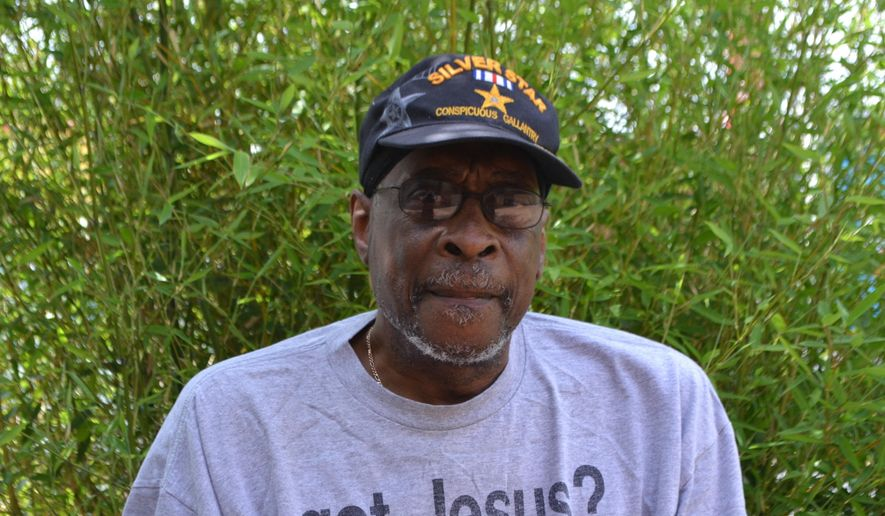 ADVANCE FOR USE SATURDAY, JULY 23, 2016 - In this recent photo, Lorenzo Everett, a Vietnam Veteran, poses in Martinsburg, W.Va. Whether he's preaching at Destiny Baptist Church on a Sunday morning, or serving breakfast to children at Burke Street Elementary School, Everett does whatever he can to make a positive impact on his community.(Mary Stortstrom/The Journal via AP) MANDATORY CREDIT