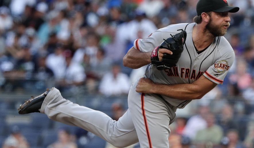 San Francisco Giants starter Madison Bumgarner follows through on a pitch to the New York Yankees during the first inning of a baseball game, Friday, July 22, 2016, in New York. (AP Photo/Julie Jacobson)
