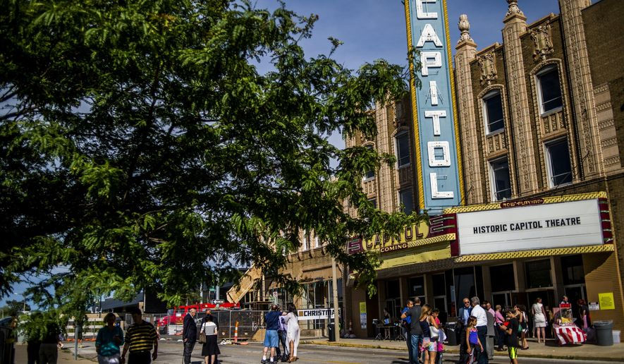 In this Thursday, July 21, 2016 photo, attendees arrive for a tour of the Capitol Theatre in downtown Flint, Mich. Visitors toured the historic theater on Thursday evening and got an update on the project just days after a $15 million gift from the Charles Stewart Mott Foundation was announced to boost the project. (Jake May/The Flint Journal-MLive.com via AP)