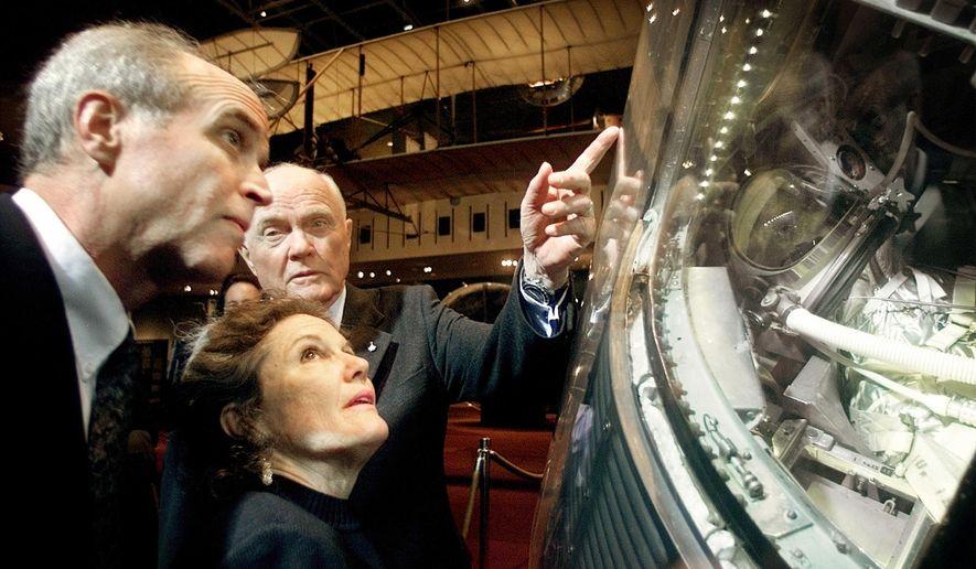 FILE - In this Feb. 20, 2002, file photo, former U.S. Sen. John Glenn, D-Ohio, right, shows his son David Glenn, left, and daughter Lyn Glenn the Mercury spacecraft Friendship 7, in which he became the first American in orbit, during a ceremony marking the 40th anniversary of the first U.S. manned orbital flight at the Smithsonian Institution's National Air and Space Museum in Washington. Nate D. Sanders Auctions says in-flight instructions used by Glenn as he became the first American to orbit the Earth sold for $66,993 on Thursday, July 21, 2016, in Los Angeles. (AP Photo/Pablo Martinez Monsivais, File)