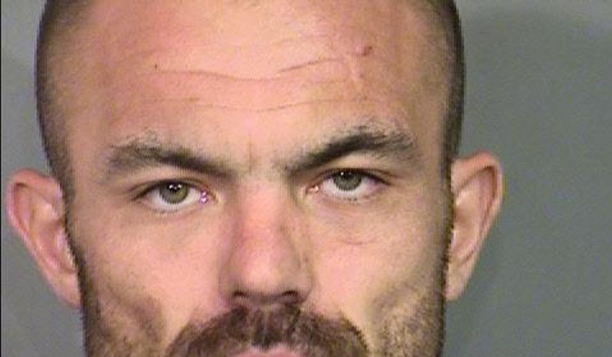 This July 7, 2016, booking photo released by the Clark County Detention Center shows Shawn Bradley Eisenman, 30, of Las Vegas. Eisenman, an ex-convict, was being held on attempted murder, assault and weapon charges when he was named Friday, July 22, 2016, as the suspect in separate killings of a man last Dec. 9, 2015, and a woman on July 3, 2016, in Las Vegas. (Las Vegas Metropolitan Police Department via AP)