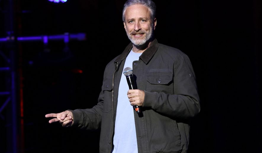 "In this Tuesday, Nov. 10, 2015, file photo, comedian Jon Stewart performs at the 9th Annual Stand Up For Heroes event, in New York. Stewart delivered a riff reminiscent of his ""Daily Show"" days during an appearance on CBS' ""Late Show with Stephen Colbert"" on July 21, 2016. (Photo by Greg Allen/Invision/AP, File)"