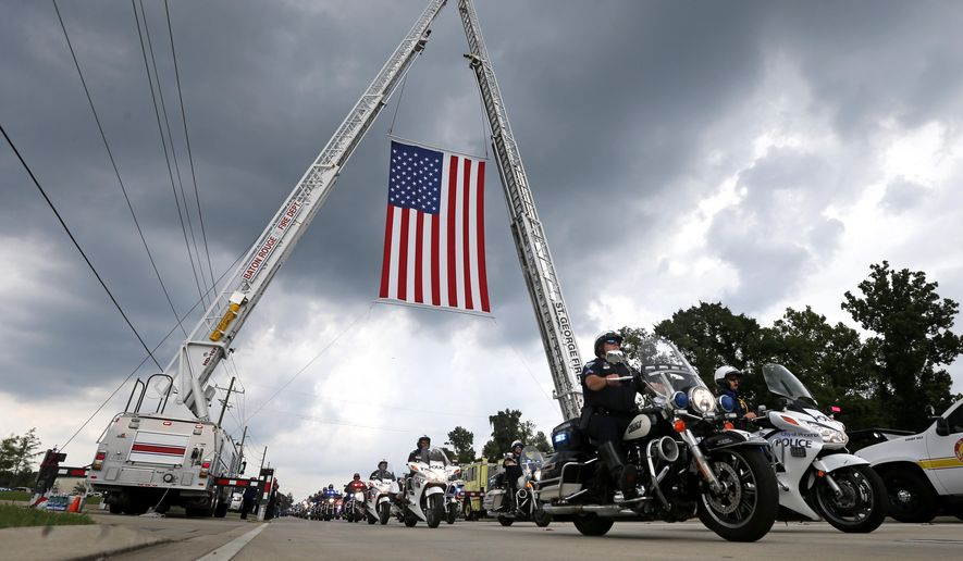 Police motorcycles lead the procession to the cemetery after funeral services for Baton Rouge police officer Matthew Gerald at the Healing Place Church in Baton Rouge, La., Friday, July 22, 2016. Multiple police officers were killed and wounded Sunday morning in a shooting near a gas station in Baton Rouge, less than two weeks after a black man was shot and killed by police here, sparking nightly protests across the city. (AP Photo/Gerald Herbert)