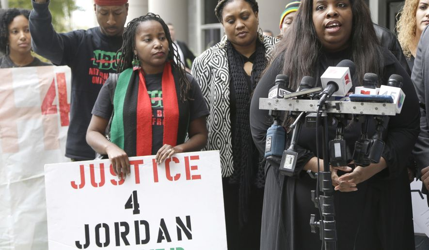 File - Janet Baker, right, speaks to reporters during a press conference outside the federal courthouse in this Dec. 2, 2015, file photo from Houston. Baker had filed a wrongful death lawsuit in the 2014 death of her 26-year-old son Jordan Baker who was fatally shot by Houston police. A recent study that found Houston officers are less likely to shoot at blacks and Hispanics than whites is prompting debate over the role racial bias can play in police shootings and highlighting the need for comprehensive nationwide data on these incidents. (AP Photo/Pat Sullivan, File)