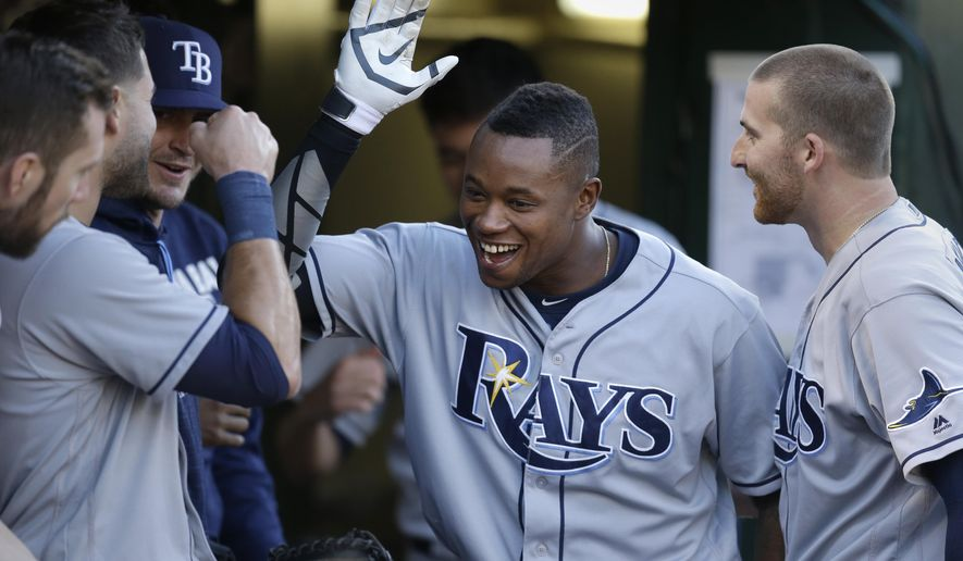 Tampa Bay Rays' Tim Beckham celebrates after hitting a home run off Oakland Athletics' Sonny Gray in the second inning of a baseball game Thursday, July 21, 2016, in Oakland, Calif. (AP Photo/Ben Margot)