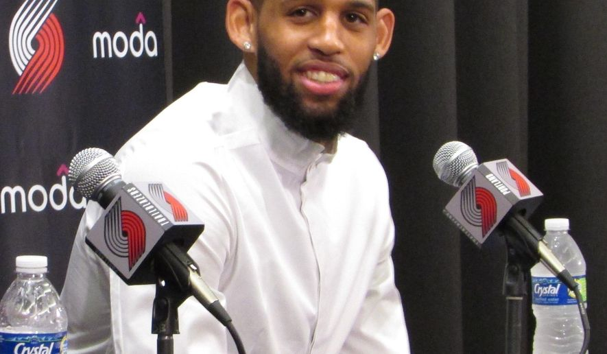 Portland Trail Blazers guard Allen Crabbe discusses his new contract with the team at a news conference at the team's practice facility in Tualatin, Ore., Friday, July 22, 2016. (AP Photo/Anne M. Peterson)