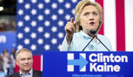 Democratic presidential candidate Hillary Clinton accompanied by Sen. Tim Kaine, D-Va., speaks at a rally at Florida International University Panther Arena in Miami, Saturday, July 23, 2016. Clinton has chosen Kaine to be her running mate. (AP Photo/Andrew Harnik) ** FILE **