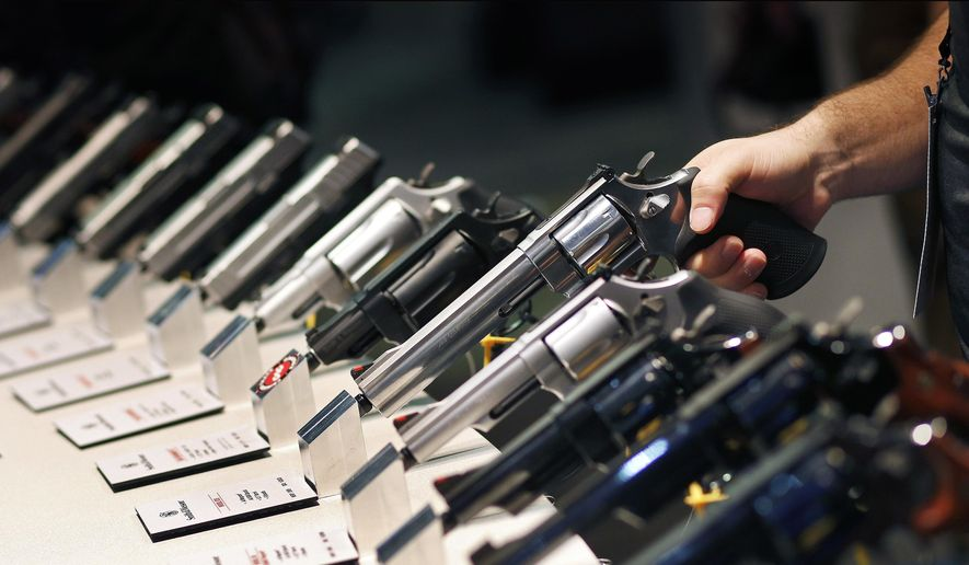 Handguns are displayed at the Smith & Wesson booth at the Shooting, Hunting and Outdoor Trade Show in Las Vegas, in this Jan. 19, 2016, file photo. (AP Photo/John Locher, File)
