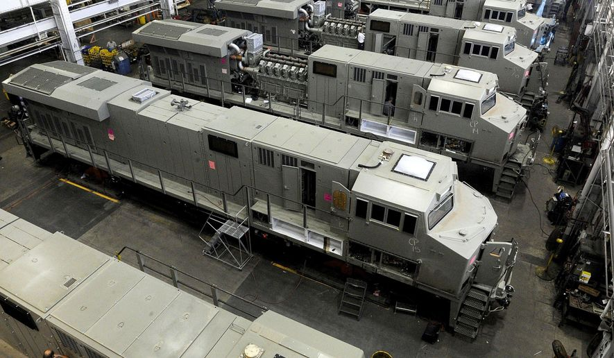 ADVANCE FOR USE SATURDAY, JULY 23 - This July 15, 2016 photo, General Electric Evolution Series locomotives are assembled  in Building 10 at GE Transportation in Lawrence Park Township, Erie County, Pa. In the summer of 2016, officials at the plant proposed a redesign of the manufacturing process to make the plant more efficient. (Jack Hanrahan/Erie Times-News via AP)
