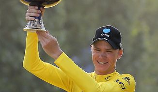 2016 Tour de France winner Chris Froome of Britain celebrates on the podium after the twenty-first and last stage of the Tour de France cycling race in Paris, France, Sunday, July 24, 2016. (AP Photo/Laurent Cipriani)