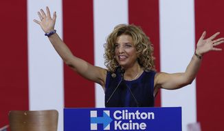 In this Saturday, July 23, 2016 photo, DNC Chairwoman, Debbie Wasserman Schultz speaks during a campaign event for Democratic presidential candidate Hillary Clinton during a rally at Florida International University Panther Arena in Miami.  On Sunday, Wasserman Schultz announced she would step down as DNC chairwoman at the end of the party's convention, after some of the 19,000 emails, presumably stolen from the DNC by hackers, were posted to the website Wikileaks. (AP Photo/Mary Altaffer)