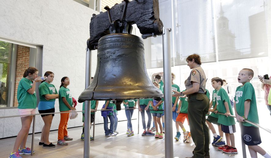 National Park Service guide Terry Papavasilis talks with visitors about the Liberty Bell at Independence National Historical Park in Philadelphia in this Sept. 30, 2013 file photo. The Libertarian and Green Parties both met the August 1 filing deadline to appear on the Nov. 8 presidential ballot in the key swing state of Pennsylvania. (AP Photo/Matt Rourke, File)