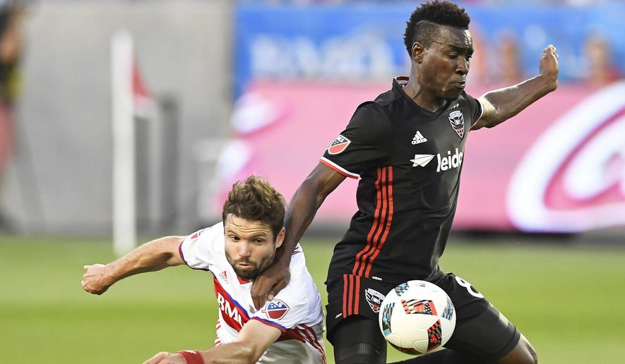 Toronto FC's Drew Moor, left, and D.C. United's Lloyd Sam vie for the ball during the first half of an MLS soccer match in Toronto on Saturday, July 23, 2016. (Frank Gunn/The Canadian Press via AP)