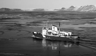 The Canadian Coast Guard's Amundsen sails in the Northwest Territories. Canadian Prime Minister Stephen Harper has announced the country will now require all vessels using the Northwest Passage to report their journeys for tracking.  (Associated Press)