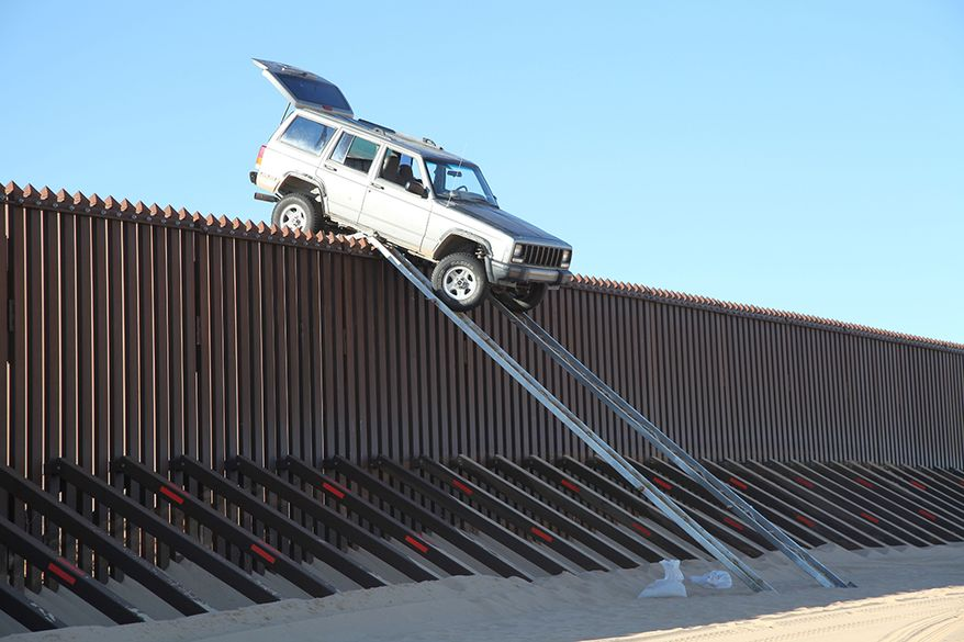 """U.S. Border Patrol agents from Yuma Sector's Yuma Station foiled a smuggling attempt today when suspects attempting to drive a vehicle over the border fence fell prey to their own devices. Smugglers attempted to drive over the International Boundary fence using a make-shift ramp that was not quite up to the task. Just after midnight this morning, agents patrolling in the Imperial Sand Dunes area encountered a silver Jeep Cherokee attempting to drive over the International Boundary fence using a make-shift ramp that was not quite up to the task. When the vehicle made it to the top of the ramp, it became """"high centered."""""""